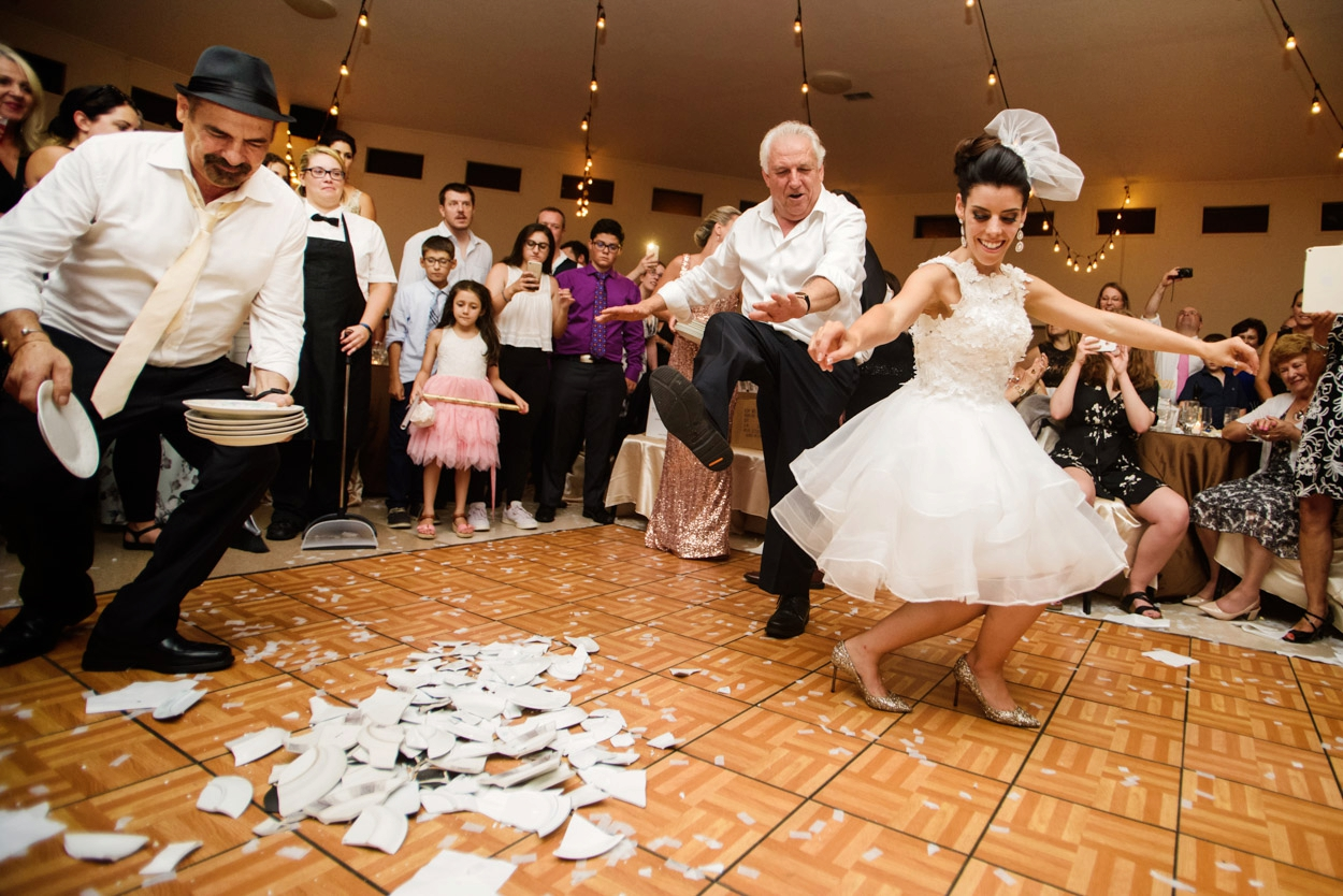 Breaking the plates // Greek Wedding Victoria BC // Photos by FunkyTown Photography Victoria BC
