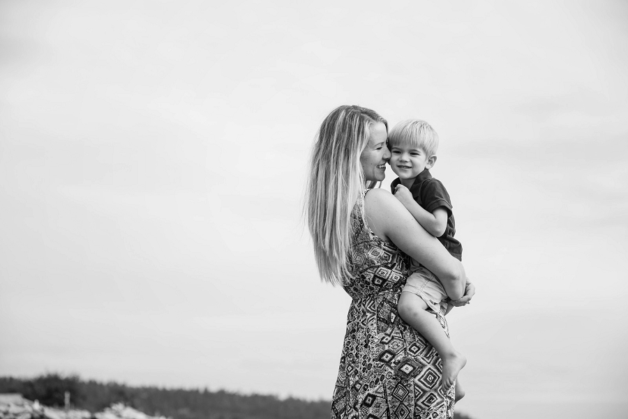 Natural and candid family portraits at the Esquimalt Lagoon in Victoria British Columbia by photographer Christina Craft.